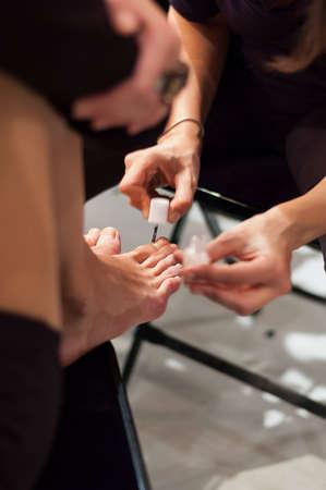 toenail: putting on toenail polish Stock Photo