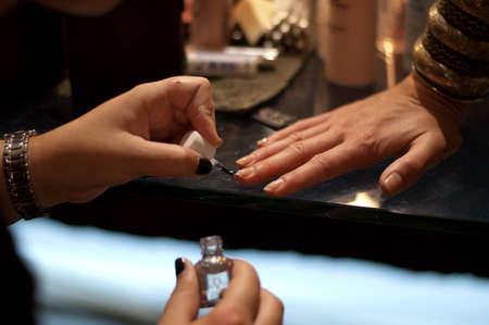 polish: putting on nail polish