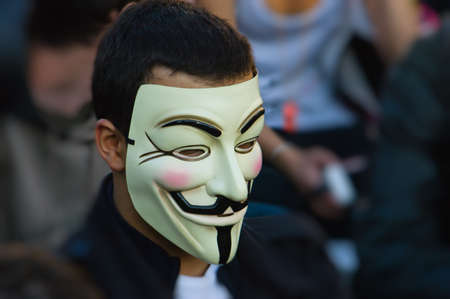guy fawkes mask: Protestor Wearing Guy Fawkes Mask  Editorial