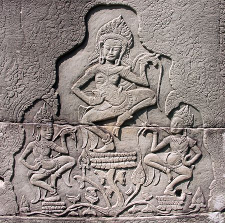 Dancing devatas - stone engraving on the wall of the Bayon Temple in Siem Reap, Cambodia Stock Photo