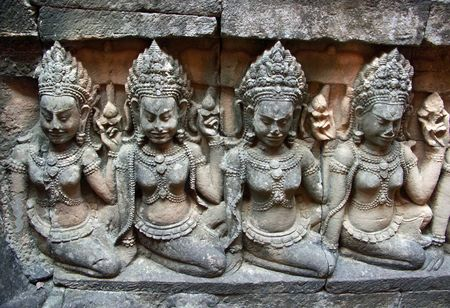 Statues of three girls in the Cambodian (Khmer) kings harem. Siem Reap, Cambodia