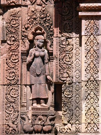 Engraving of a devata on the Banteay Srei Temple wall - Siem Reap, Cambodia