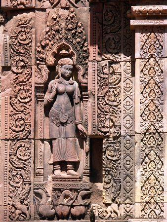Engraving of a devata on the Banteay Srei Temple wall - Siem Reap, Cambodia Stok Fotoğraf - 245808