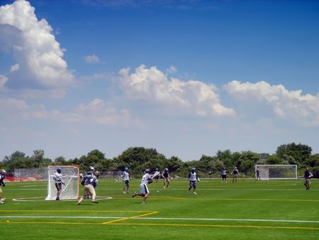 Lacrosse players in action on the Floyd Bennet field in Brooklyn, New York Stock Photo