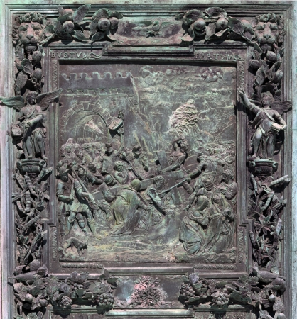 carrying: Fragment of the Pisa Cathedral bronze main doors that were made in the workshops of Giambologna