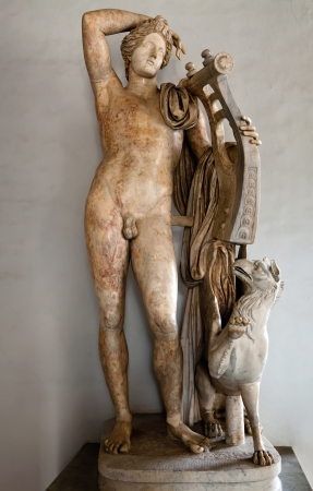 Ancient Roman statue of Apollo holding a lyre