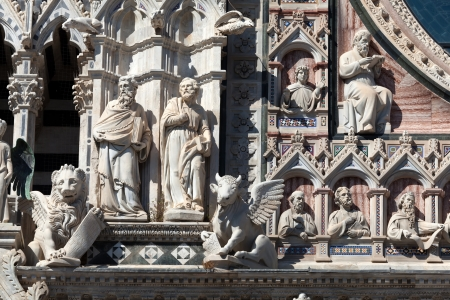 Decorations on the walls of the Cathedral of Siena, Italy photo