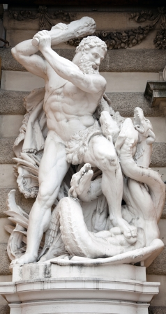 chiseled: Statue of Hercules fighting the Hydra in the Hofburg Quarters, Vienna  Stock Photo
