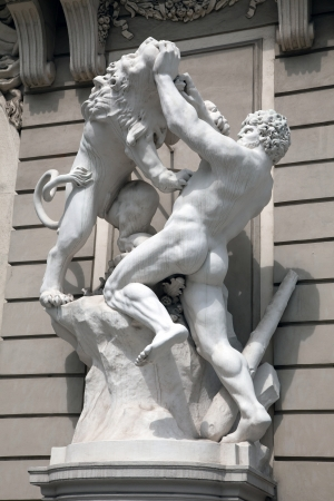 Statue of Hercules fighting the Nemean Lion in the Hofburg Quarters, Vienna  photo