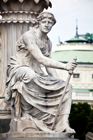 nen: A female statue representing the executive powers of the state, part of the Athena Fountain  Pallas-Athene-Brun nen   Stock Photo