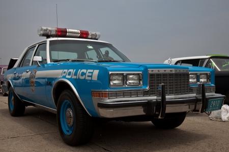 custom car: Plymouth police car at the Antique Automobile Association of Brooklyn Dust Off Car Show on June 12, 2011 at Floyd Bennett Field in Brooklyn, New York, USA.