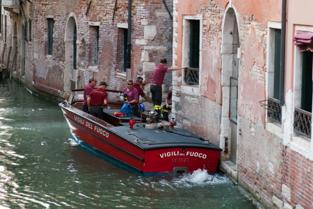Venetian firefighters responding to a fire accident