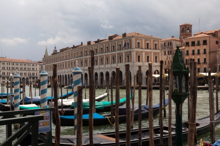 Mooring posts and channel markers feature prominently in the crowded waterways of Venice.