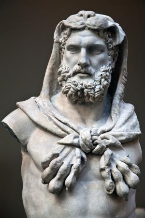 greek statue: Statue of Hercules wearing the skin of the Nemean lion