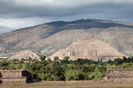 Teotihuacan is an enormous archaeological site in the Basin of Mexico, just 30 miles northeast of Mexico City, containing some of the largest pyramidal structures built in the pre-Columbian Americas   photo