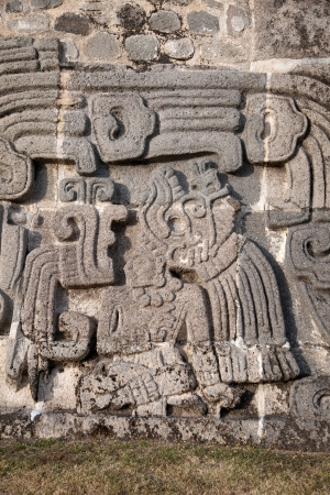 feathered: The Temple of the Feathered Serpent in Xochicalco has fine stylized depictions of that deity in a style which includes apparent influences of Teotihuacan and Maya art