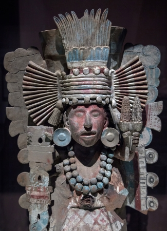 Pre-Columbian Mesoamerican stone statue depicting a warrior with an elaborate feather  headdress photo