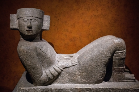 pre columbian: Chac-Mool is the name given to a type of Pre-Columbian Mesoamerican stone statue  The Chac-Mool depicts a human figure in a position of reclining with the head up and turned to one side, holding a tray over the stomach   Stock Photo
