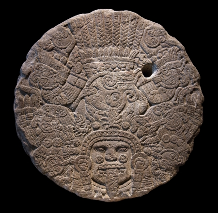 identified: Stone altar disk to Tlaltecuhtli, Lord of the Earth  Tlaltecuhtli is a pre-Columbian Mesoamerican deity figure, identified from sculpture and iconography dating to the Late Postclassic period of Mesoamerican chronology  ca  1200�1519 , primarily among the