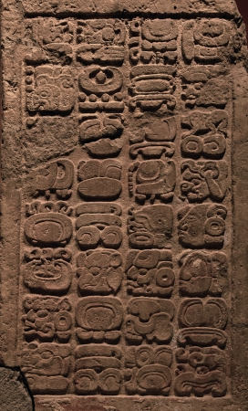 Ancient Mayan hieroglyphs carved on a stone tablet 版權商用圖片