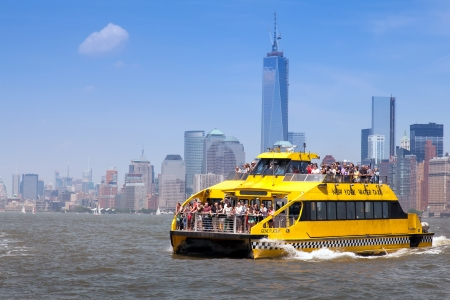 New York City Water Taxi in front of the NYC skyline on June 1st, 2013. New York Water Taxi provides the most exciting & entertaining NYC boat tours.