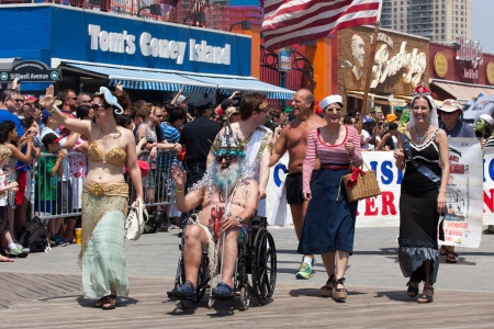 Unidentified participants of the 29th annual Coney Island Mermaid Parade on June 22, 2013 at Coney Island, Brooklyn, NY, USA.