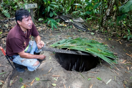 hidden danger: Ecuadorian guide is demonstrating techniques used by local Indians for animal trapping in the Napo River jungle