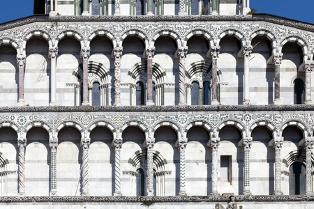christendom: Details of the facade of the San Martino Cathedral in Lucca, built in 1070 to house one of the most renowned artifacts in Christendom, the Volto Santo, a venerated wooden corpus of a crucifix