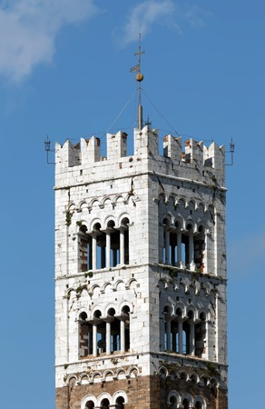 christendom: Bell Tower of the San Martino Cathedral in Lucca, built in 1070 to house one of the most renowned artifacts in Christendom, the Volto Santo, a venerated wooden corpus of a crucifix  Stock Photo