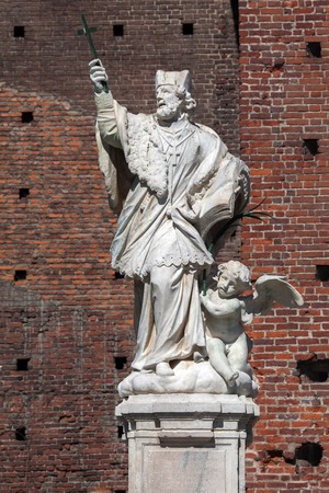 sforza: Statue of St John of Nepomuk at the courtyard of Sforza Castle in Milan Italy