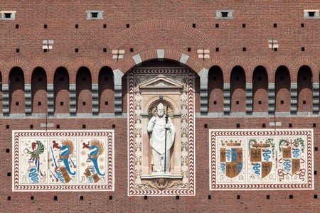 devouring: Coat of arms of the Visconti family on the wall of the Filarete Tower of the Castello Sforzesco in Milan