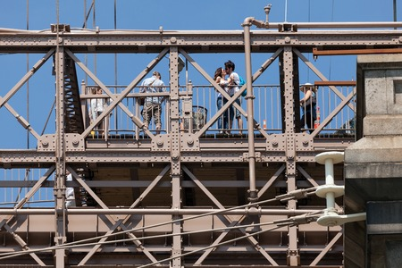 pedestrian bridges: NEW YORK USA  MAY 25 2015: The Brooklyn Bridge one of the oldest bridges in US has a wide pedestrian walkway open to walkers and cyclists attacting large crowds of tourists. Editorial
