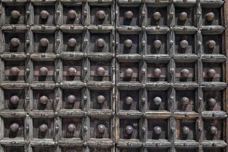commissioned: Medieval wooden doors of the Naples Cathedral, the main church of Naples, southern Italy, commissioned by King Charles I of Anjou, completed in the early 14th century under Robert of Anjou. Stock Photo