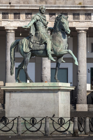 ferdinand: Statue of Ferdinand IV of Naples, of the Bourbon dynasty at Piazza Plebiscito in Naples, Italy. The monarch is mounted and dressed in classical fashion. Stock Photo