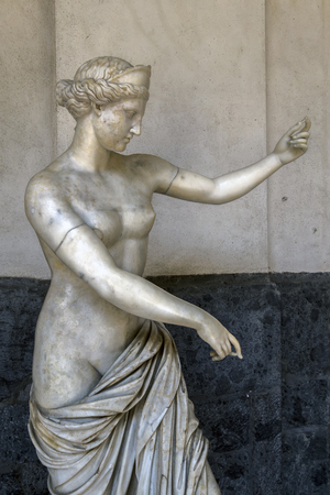 NAPLES, ITALY - JULY 22 2015: Ancient Roman statue of Aphrodite from the Campania Amphitheatre, made from the fine-grained white marble, on display at the Naples National Archaeological Museum.