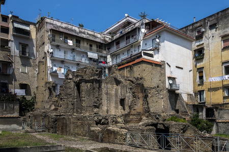 archaeological complex: NAPLES, ITALY - JULY 24 2015: Ruins of the Carminiello ai Mannesi Archaeological Complex, an ancient Roman archaeological site that dates to the 1st century BC, surrounded by residental buildings.