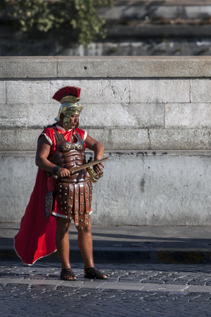 ROME, ITALY - JULY 29 2015: Men dressed up as a Roman legionnaires are a frequent sight on the streets of Rome, Italy. They are making money mostly by posing for pictures with tourists. Editorial