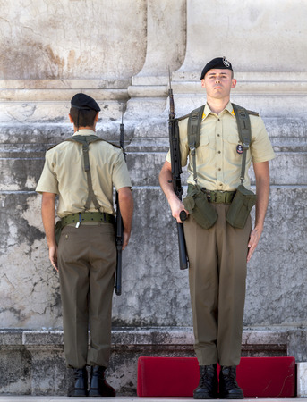 tomb unknown soldier: ROME, ITALY - JULY 29 2015: Tomb of the Unknown Soldier, inaugurated in 1921. Guards of honor, alternatively selected from the marine, infantry and air divisions, stand on guard here day and night. Editorial