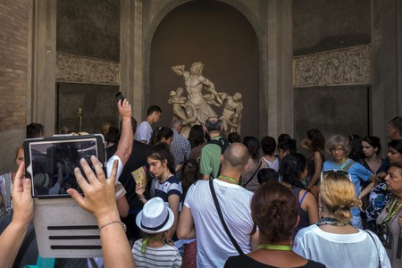 serpents: ROME, ITALY - JULY 31 2015: The 1st-century AD marble group of the Trojan priest Laocoon and his sons struggling with two serpents draws large tourist crowds in the Vaticans Pio-Clementine Museum.