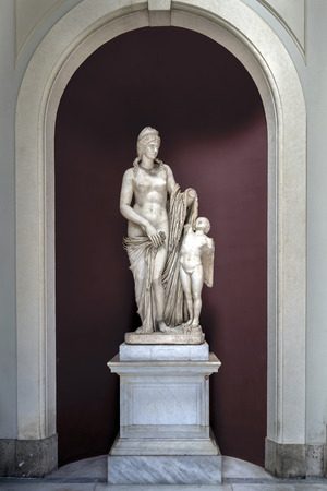 matron: Venere Felice statue in the Vatican Museum, inspired by Praxiteles Aphrodite of Cnidus, most likely depicts a Roman matron and her young son in the guise of Eros. Stock Photo