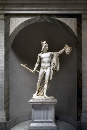 triumphant: Perseus statue in the Vatican Museums, carved by Antonio Canova. The statue shows the triumphant Perseus holding the severed head of the Medusa, one of the three Gorgons. Stock Photo