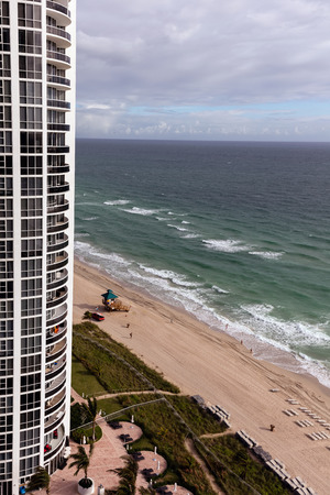 isles: SUNNY ISLES BEACH, FL - DECEMBER 26 2015: Trump International Beach Resort rises as a striking landmark to luxury amidst the white sands of Miami Beach. Editorial