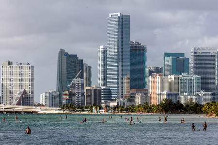 windsurfers: MIAMI - DECEMBER 30 2015: Hobie Beach is Miamis most popular beach for windsurfers and dog lovers, located in a narrow strip along the Rickenbacker Causeway in Key Biscayne. Editorial