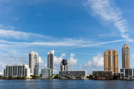 isles: SUNNY ISLES BEACH, FL - JANUARY 1 2016: Skyline of the Sunny Isles Beach city located on a barrier island in northeast Miami-Dade County, Florida, often referred to as Floridas Riviera.