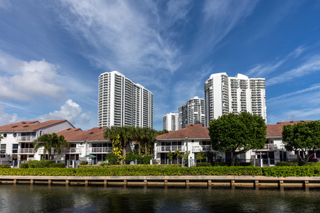 barrier island: SUNNY ISLES BEACH, FL - JANUARY 1 2016: Luxury villas in the Sunny Isles Beach, located on a barrier island in northeast Miami-Dade County, Florida.