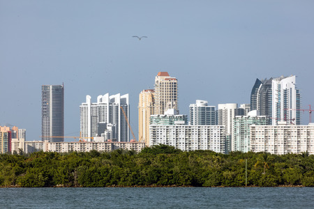 SUNNY ISLES BEACH, FL - JANUARY 1 2016: Skyline of the Sunny Isles Beach city located on a barrier island in northeast Miami-Dade County, Florida, often referred to as Floridas Riviera.