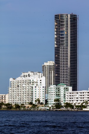 isles: SUNNY ISLES BEACH, FL - JANUARY 1 2016: The Porsche Design Tower is a skyscraper currently under construction, designed with 60 stories to become one of the tallest buildings in Sunny Isles Beach. Editorial