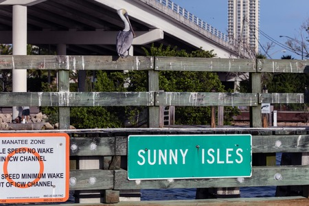 isles: SUNNY ISLES BEACH, FL - JANUARY 1 2016: The sign marks the entrance to the Sunny Isles Beach city, which is often referred to as Floridas Riviera. Editorial