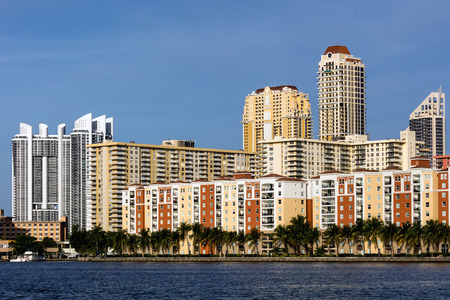 florida: SUNNY ISLES BEACH, FL - JANUARY 1 2016: Skyline of the Sunny Isles Beach city located on a barrier island in northeast Miami-Dade County, Florida, often referred to as Floridas Riviera.