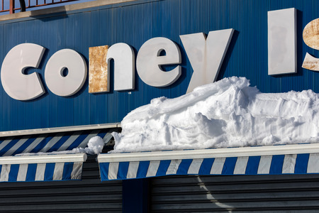 coney: BROOKLYN, NY - JANUARY 24 2016: Coney Island after the blizzard of 2016 when New York saw its second-highest snowfall since records began in 1869.